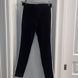 """Black """"jeggings"""" with white stripe down each side"""